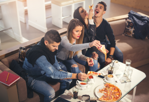 A group of friends are enjoying a pizza party - Joe's New York Style Pizza Las Vegas